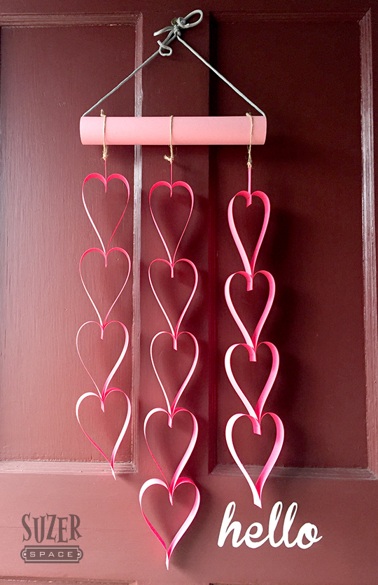These heart paper chains have been popping up everywhere. Making them into a door decoration is easy