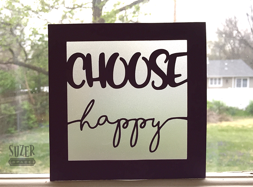 Colored paper, translucent paper and an inspirational phrase chase the clouds away in this choose happy sign. | suzerspace.com