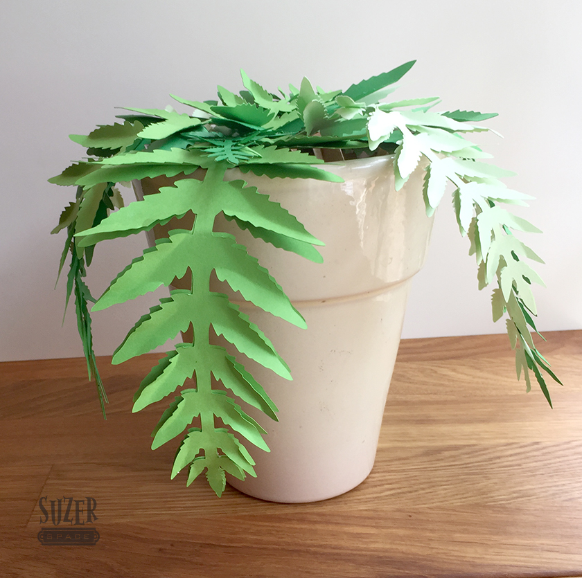 A faux fern made of paper is impossible to over or under water | suzerspace