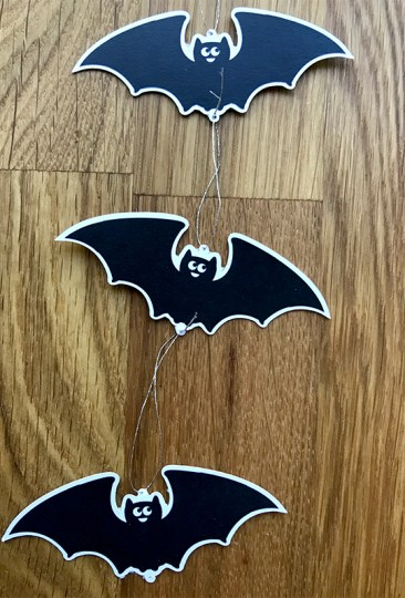 bats strung together for batty chandelier