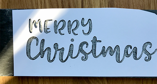 Chalkboard lettering is easier with a stencil
