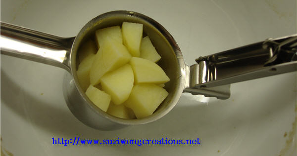 potatoes in masher