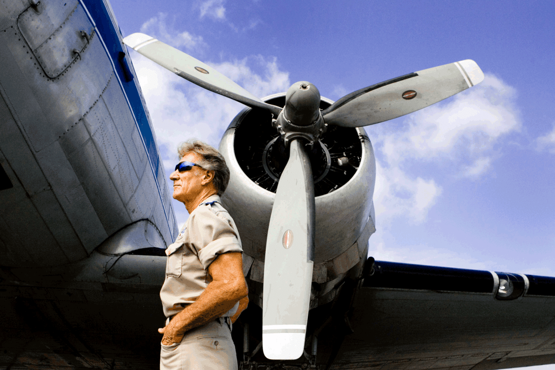 Stan Brock, the founder of Remote Area Medical, stands in front of a World War II cargo plane in Wise, Virginia. Photo by Suzy Allman