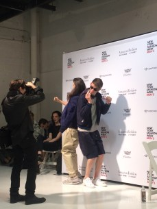 Models casually having fun and goofing around backstage