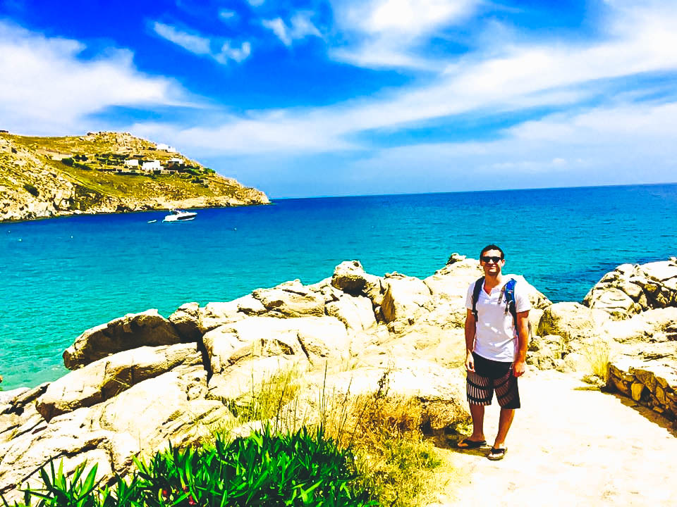 Travel Guide to Mykonos_What to do_Where to Stay_Mykonos Island_Greece_3 day itinerary_blog_Paradise BEach_hike from Paranga_Boy_Ocean_cliff view_party island