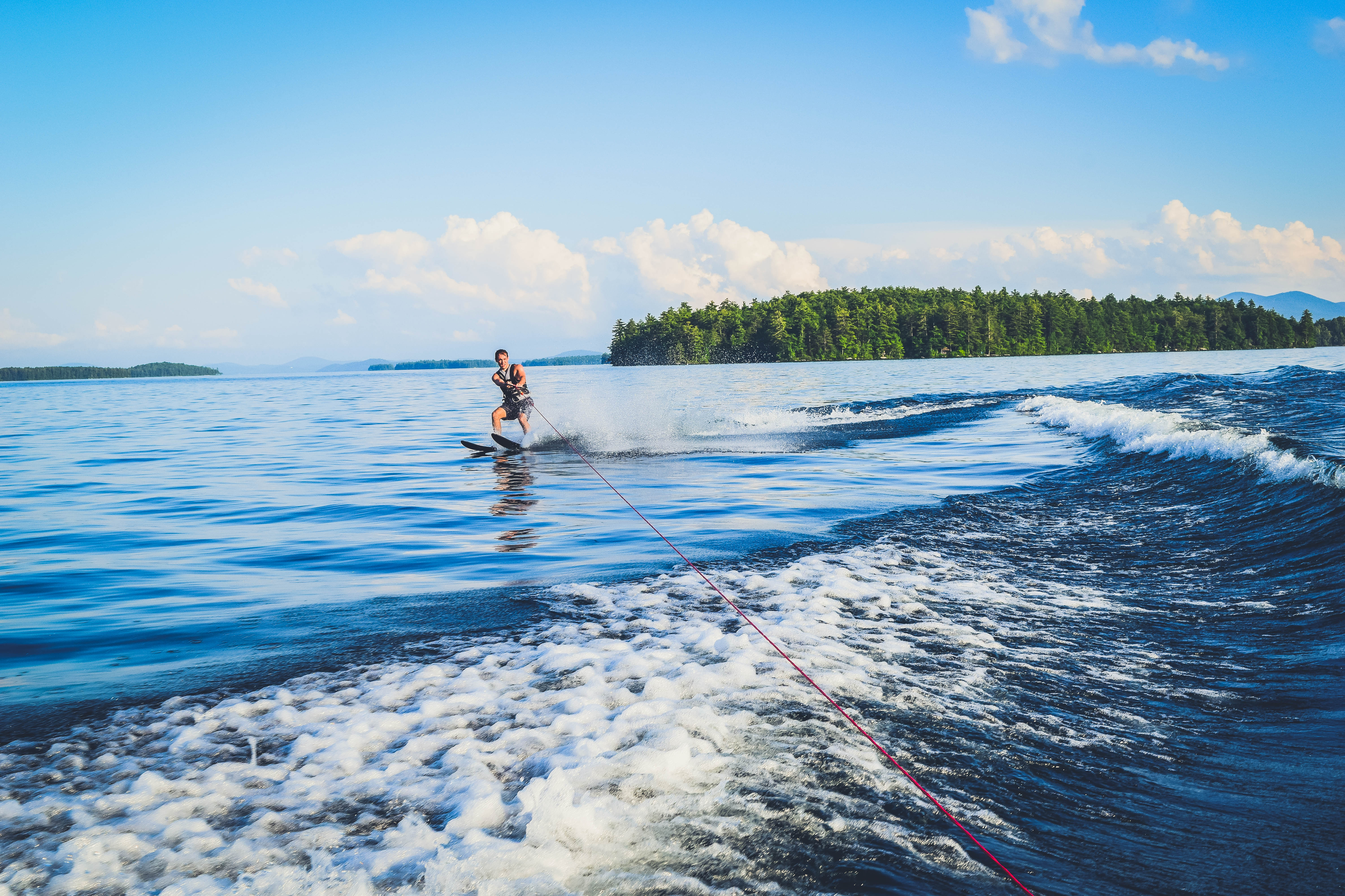 Lake Winnipesaukee_New Hampshire_Travel Guide_What to do_What to See_waterski_man_adventure_sport_water_nature_mountains