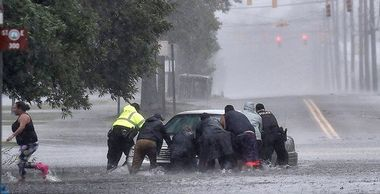 As torrential rain falls on Saturday, September 15, 2018, as police officers help civilians push a stranded motorist out of the flood water near downtown Lumberton, NC, USA, Image: 386924098, License: Rights-managed, Restrictions: , Model Release: no, Credit line: Profimedia, Abaca