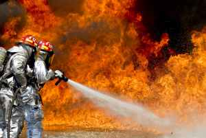 Generic photo of firefighters fighting flames. Fire Safety.