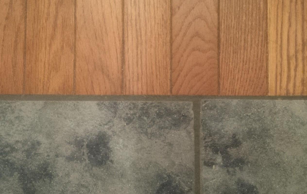 when wood floors meet tile important