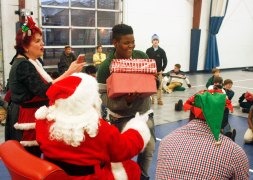 Christmas with Santa at the Family Success Center sponsored by the St. X Wrestling Team