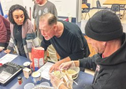 Shawnnesha Mahoney watches as the group prepares an apple crumble for cooking class.