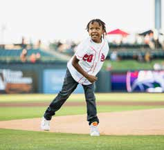 SVDP Client throws out first pitch