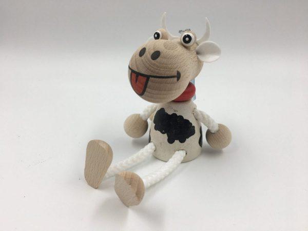 Skakač na vzmeti kravica