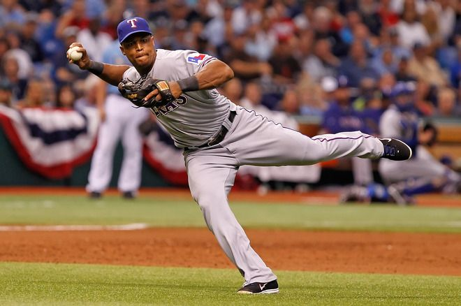 ST. PETERSBURG - OCTOBER 04:  Infielder Adrian Beltre #29 of the Texas Rangers throws over to first for an out against the Tampa Bay Rays during Game Four of the American League Division Series at Tropicana Field on October 4, 2011 in St. Petersburg, Florida.  (Photo by J. Meric/Getty Images)