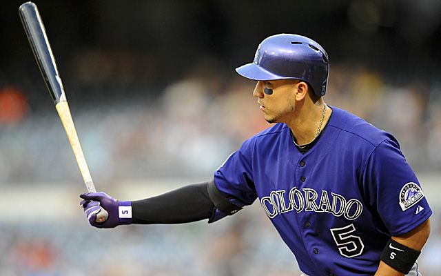 Jul 10, 2013; San Diego, CA, USA; Colorado Rockies left fielder Carlos Gonzalez (5) during his at bat in the first inning against the San Diego Padres at Petco Park. Mandatory Credit: Christopher Hanewinckel-USA TODAY Sports
