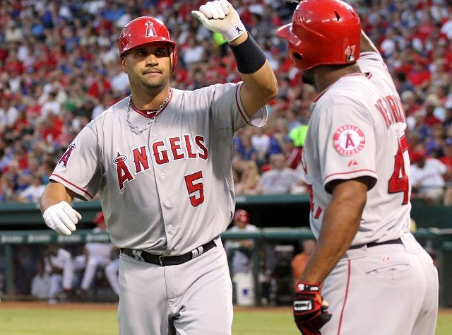 ARLINGTON, TX - JULY 31: Albert Pujols #5 of the Los Angeles Angels of Anaheim is congratulated teammate Howard Kendrick #47 after hitting a 2-run homer, his second homer of the game against the Texas Rangers in the top of  the 6th inning on July 31, 2012 at the Rangers Ballpark in Arlington in Arlington, Texas. (Photo by Layne Murdoch/Getty Images)