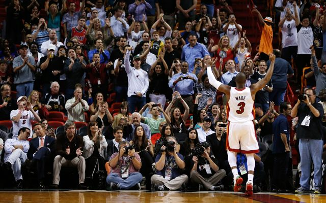MIAMI, FL - MARCH 12: Dwyane Wade #3 of the Miami Heat celebrates with fans during a game against the Atlanta Hawks at American Airlines Arena on March 12, 2013 in Miami, Florida. NOTE TO USER: User expressly acknowledges and agrees that, by downloading and or using this photograph, User is consenting to the terms and conditions of the Getty Images License Agreement. (Photo by Christopher Trotman/Getty Images) *** Local Caption *** Dwyane Wade