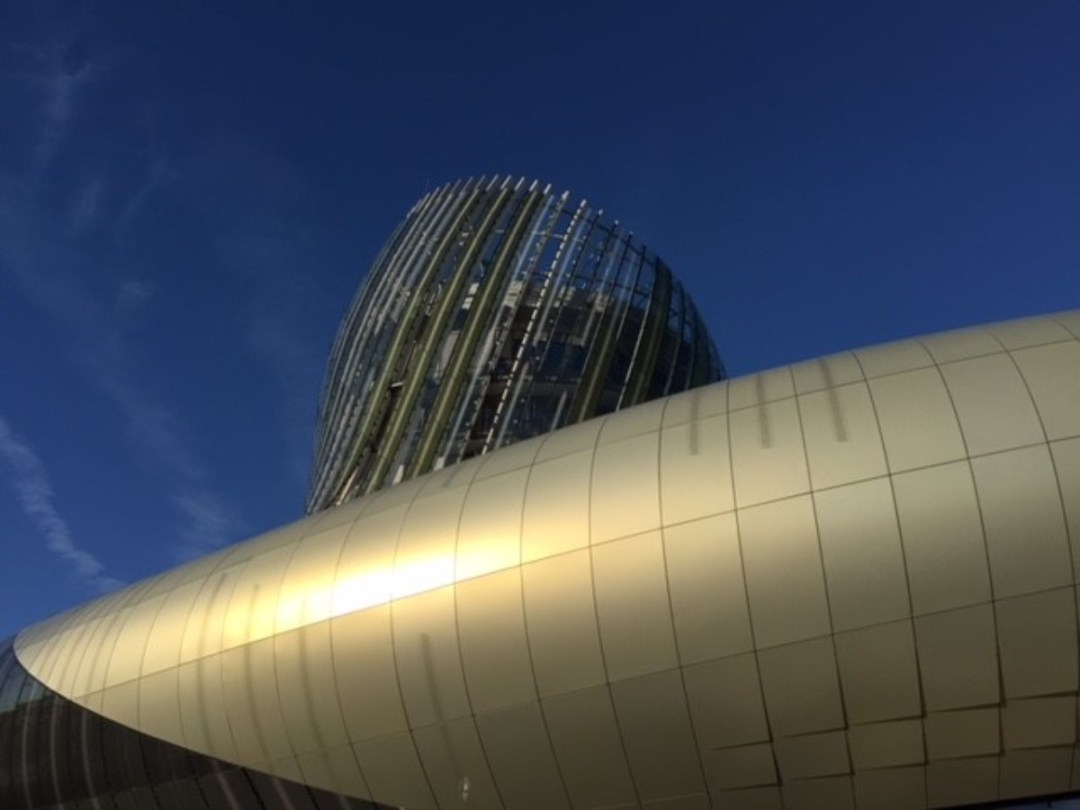 A building like a swirl of wine in a glass - John Stack