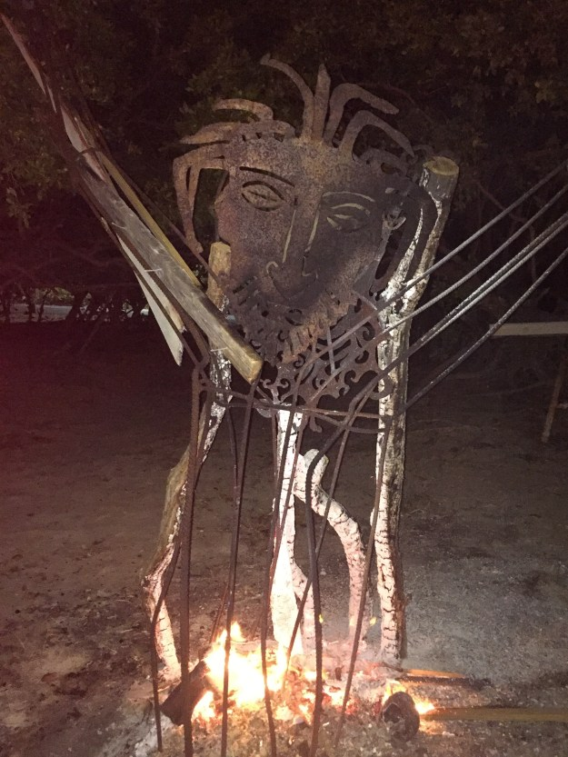 Small burning men all around the island.