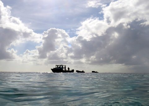 Dive boat retrieving our dinghies that floated away.