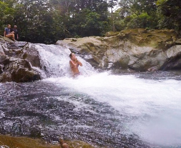 Me slipping down a little waterfall.