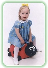 Young girl with riding toy