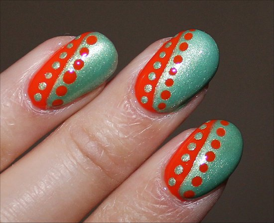 Orange Nails With Black Dots And Stripes Design Nail Art