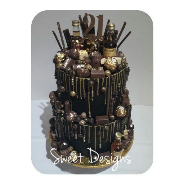 Chocolate Dripping Black and Gold Cake