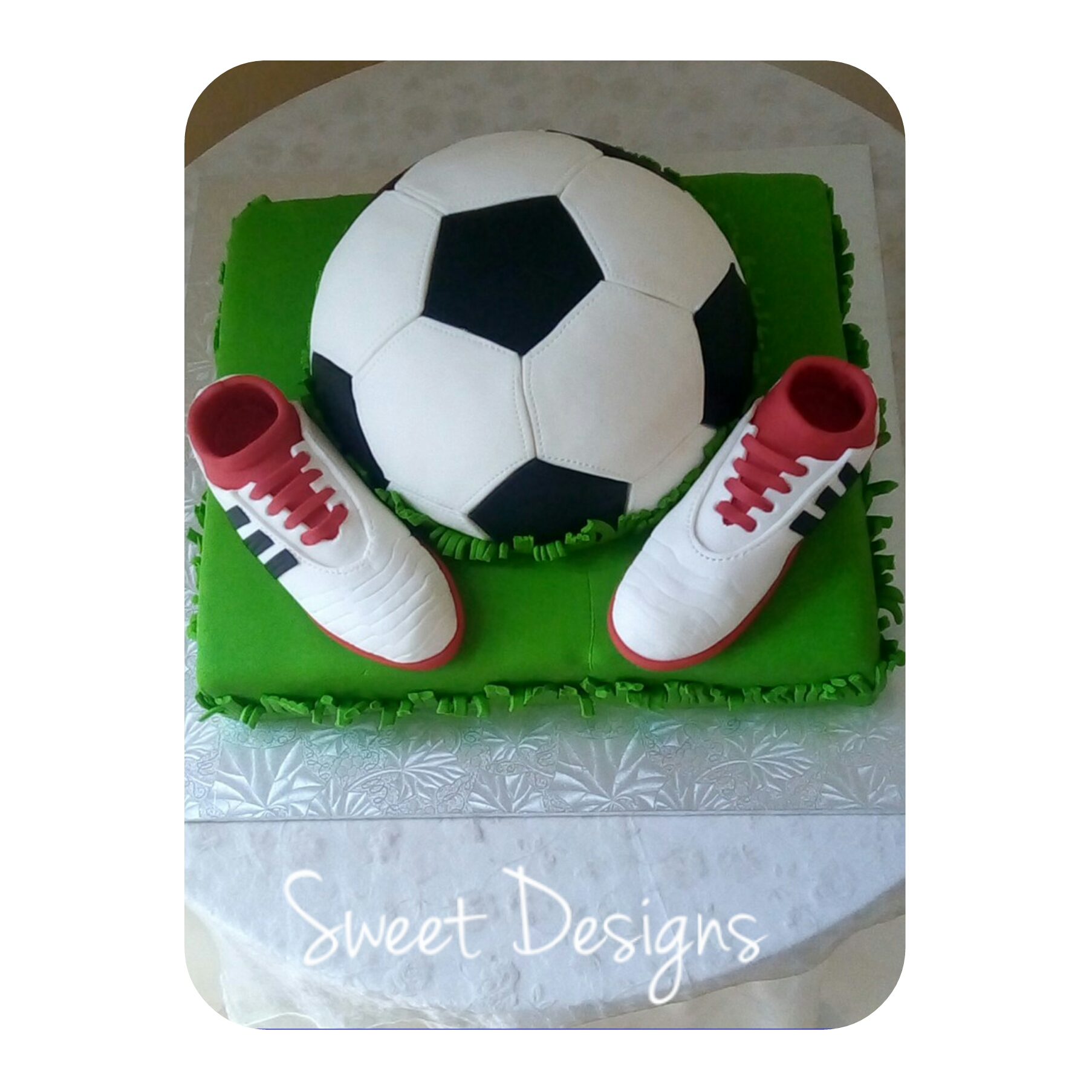 Soccer Cake with Soccer Boots made from fondant