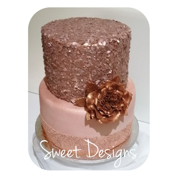 Rose Gold Birthday Cake with edible flakes on top tier