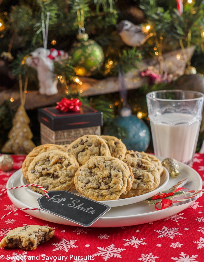 Chewy Chocolate Chip Cookies on dish with glass of milk for Santa