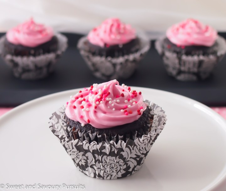 Chocolate Beet Cupcakes with Cream Cheese Icing on cake stand.