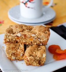 Apricot Almond Bars with dried apricots on the side.