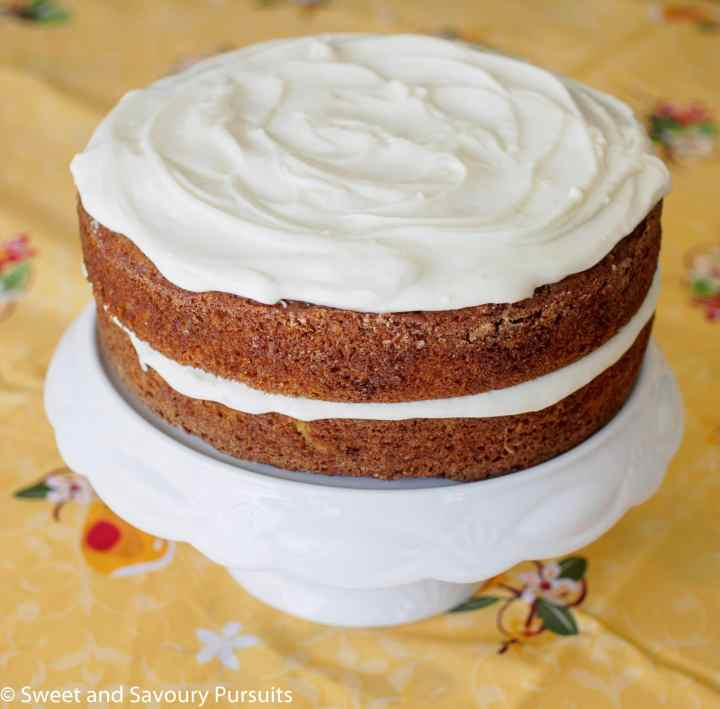 Carrot Cake with Cream Cheese Frosting on cake stand.