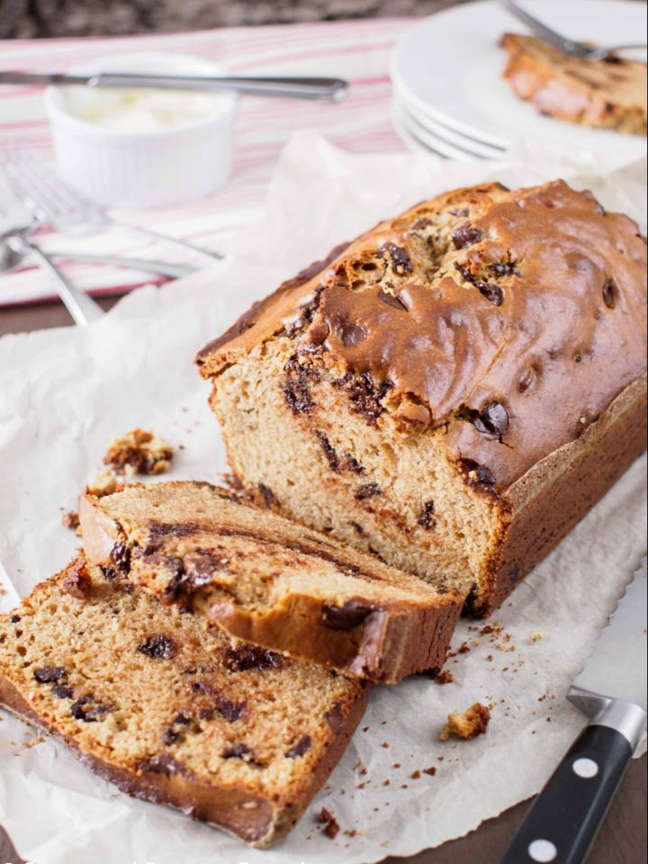 Peanut Butter and Chocolate Chip Loaf on cutting board with cut slices.