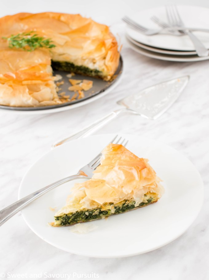 A slice of an Easy Spanakopita pie.