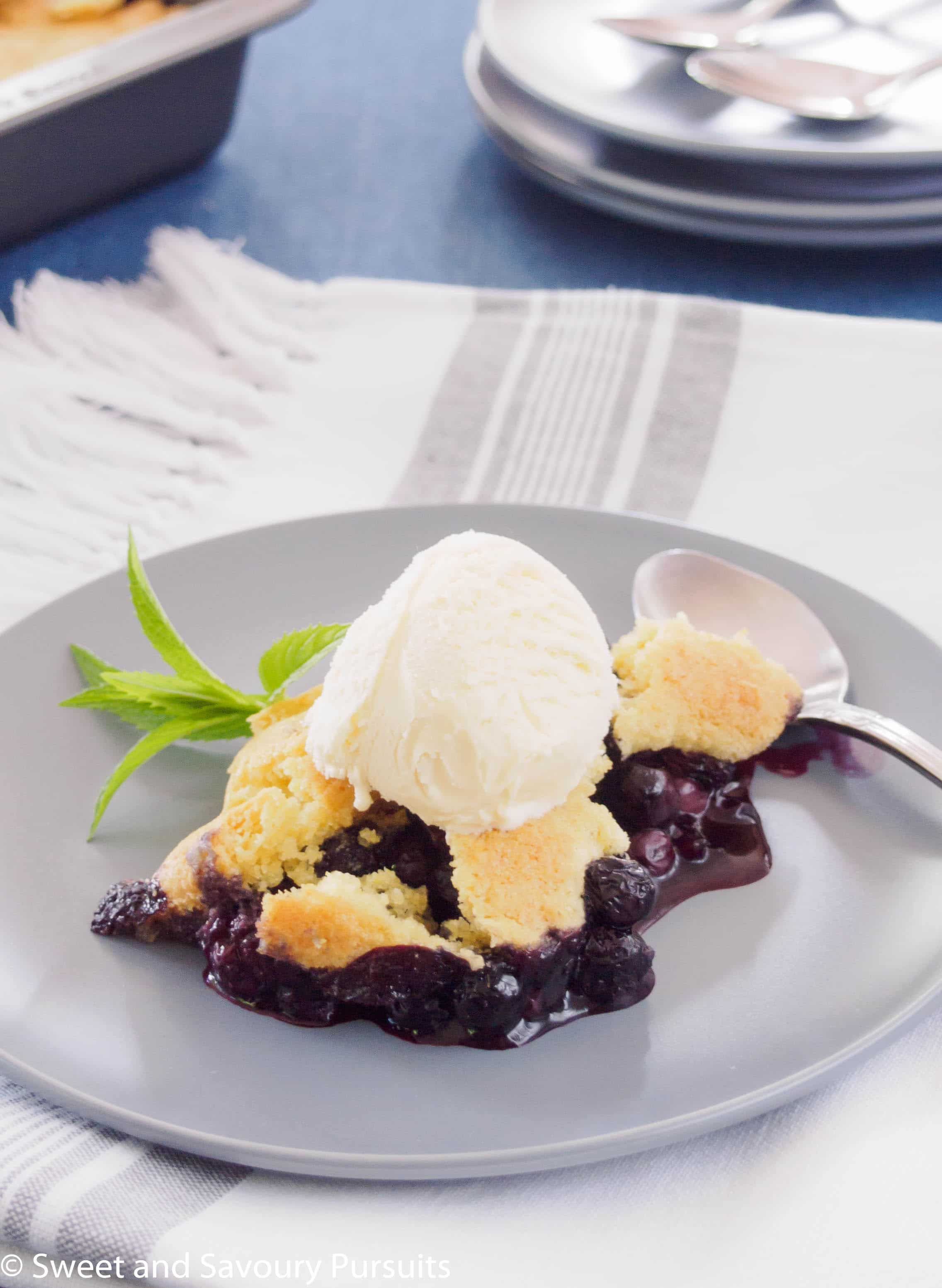 Delicious and easy to make, this Blueberry Cobbler is great for weeknight desserts or casual gatherings. Serve the cobbler warm with vanilla ice cream for the perfect summer treat!