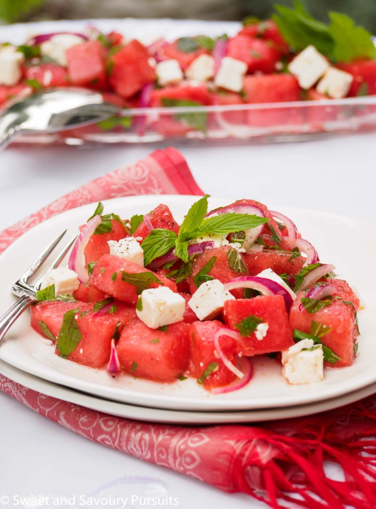 Plate of Watermelon and Feta Salad with fresh mint.