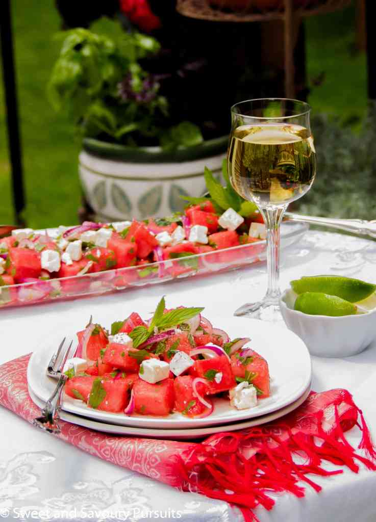 Plate of Watermelon and Feta Salad served outdoors.