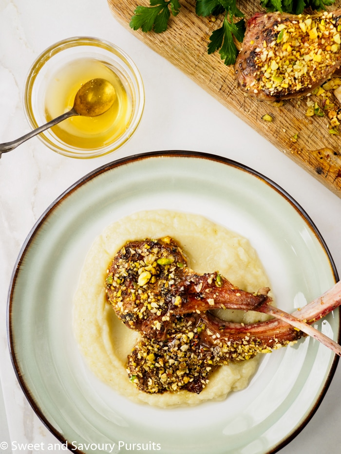 These Dukkah-Crusted Lamb Chops with Cauliflower and Potato Purée are so quick to prepare that you could easily serve this elegant dish on a weeknight! #lambchops #dukkah #Easter