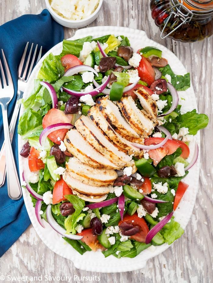 Greek Salad with Grilled Chicken served on platter.