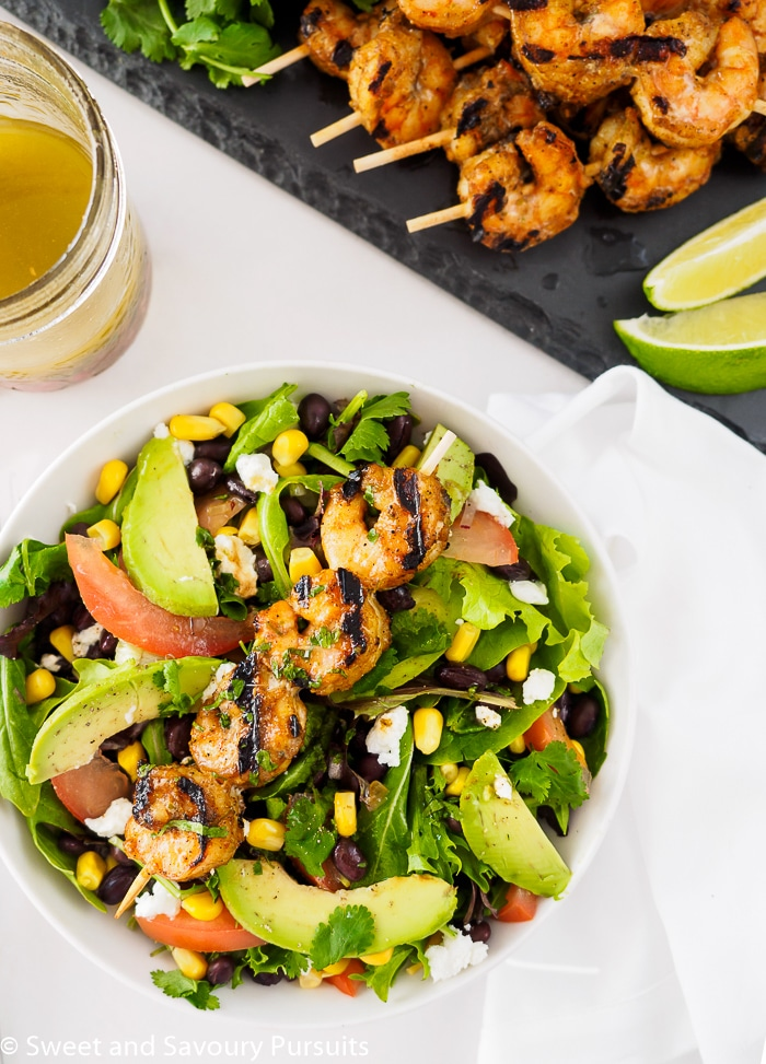 Southwestern Grilled Shrimp Salad served with extra southwest vinaigrette and lime wedges on the side.