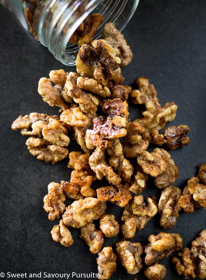 Maple Spiced Walnuts on dark background.