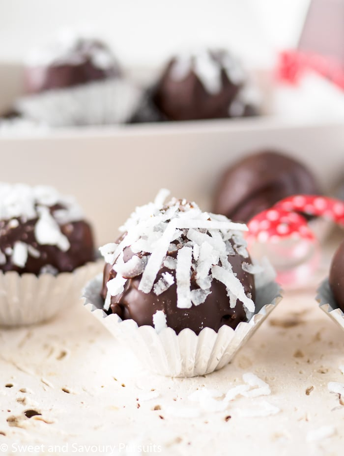 These Double Chocolate Coconut Almond Truffles are delicious tender sweet bites of coconut and white chocolate covered in luscious dark chocolate. #truffles #chocolate #coconut