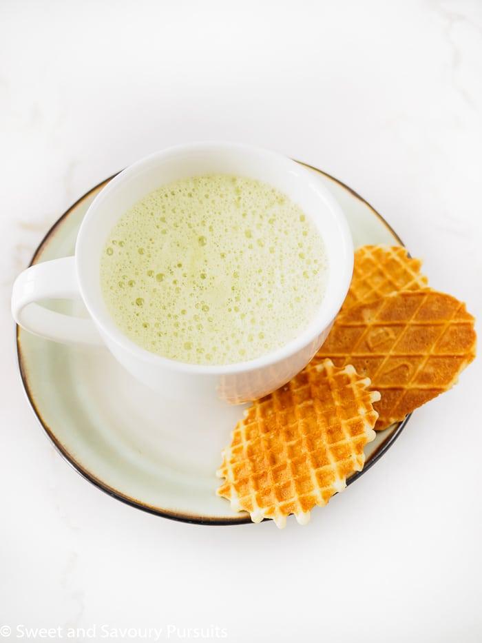 A foamy mug of Matcha Green Tea Latte.
