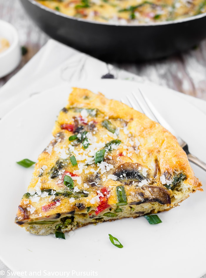 A serving of vegetable frittata on white dish