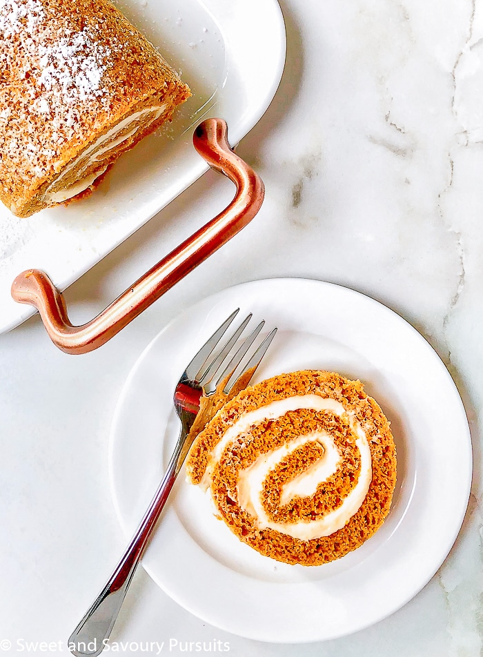 This spiced Maple Pumpkin Roll Cake with a delectable cream cheese filling is the perfect autumn dessert.