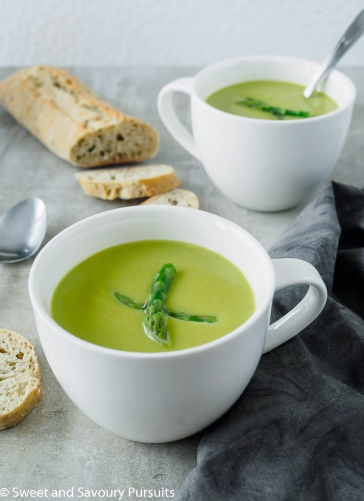 Creamy Asparagus Soup in white mugs.