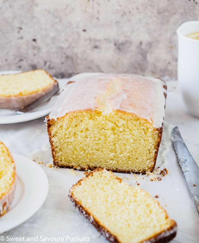 Front view of a Glazed Lemon Loaf Cake that has been cut and plated.