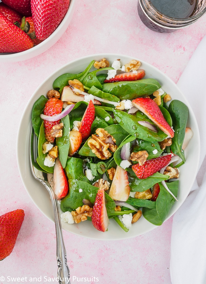 Top view of a bowl of Strawberry Spinach Salad